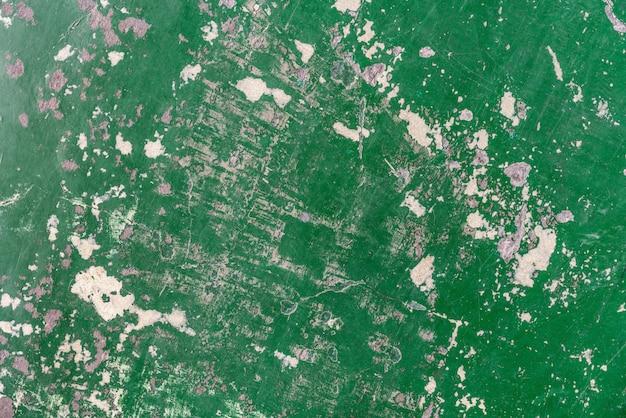 Textura verde de epoxy vieja y abandonada abstracta del piso de la grieta.