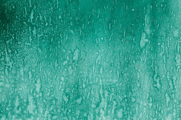 Textura verde en la pared con óxido