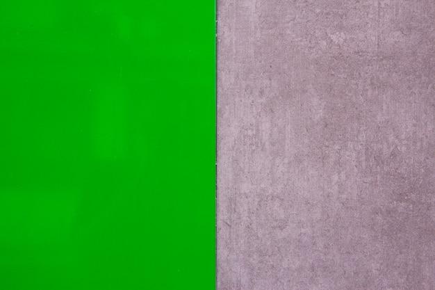 Textura verde pulida con textura de pared gris. espacio para texto. fondo. diseño moderno.