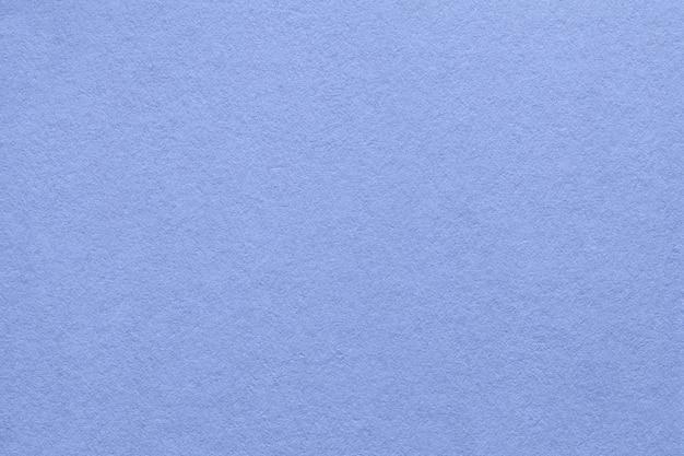 Textura del viejo fondo de papel azul, primer