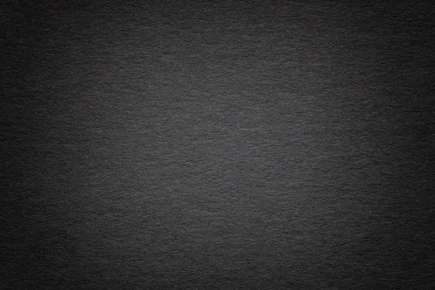 Textura del viejo fondo de papel negro oscuro, primer plano estructura de cartón denso