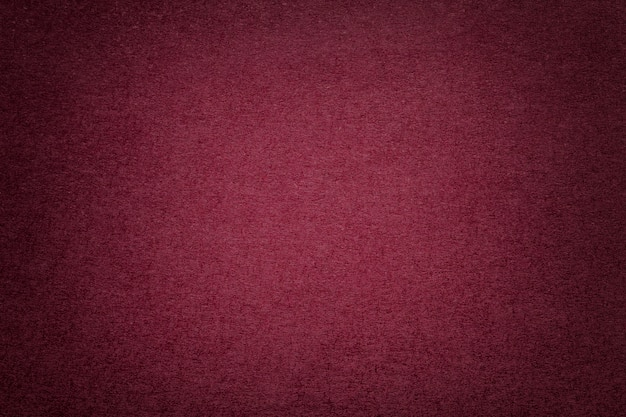 Textura del viejo fondo de papel rojo oscuro