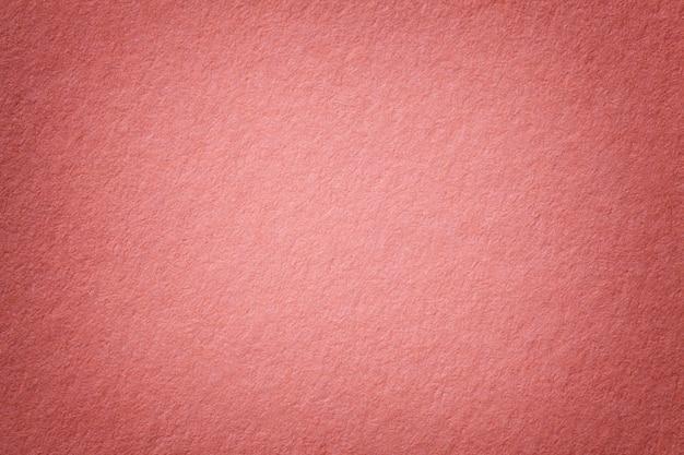 Textura del viejo fondo de papel rosado oscuro