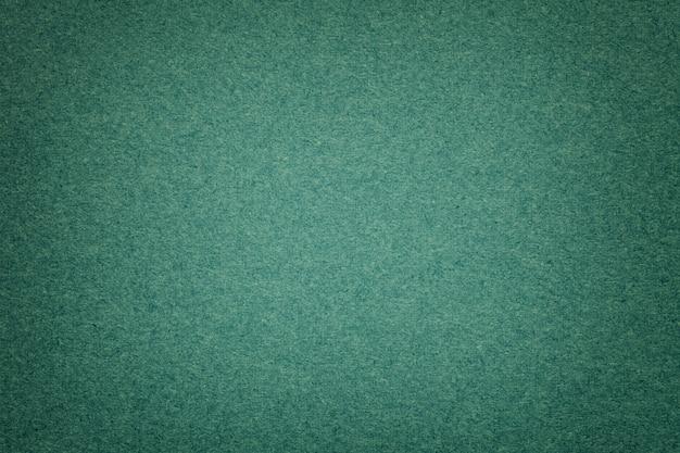 Textura del viejo fondo de papel verde oscuro