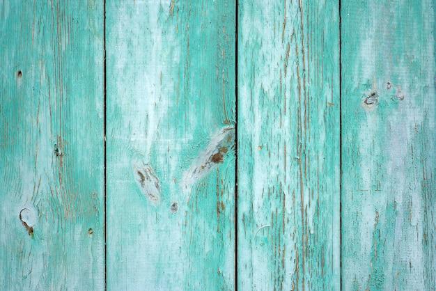 Textura del viejo fondo rústico de madera con la peladura de la pintura verde clara. horizontal.