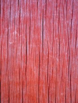 La textura del viejo tablero de madera color coral