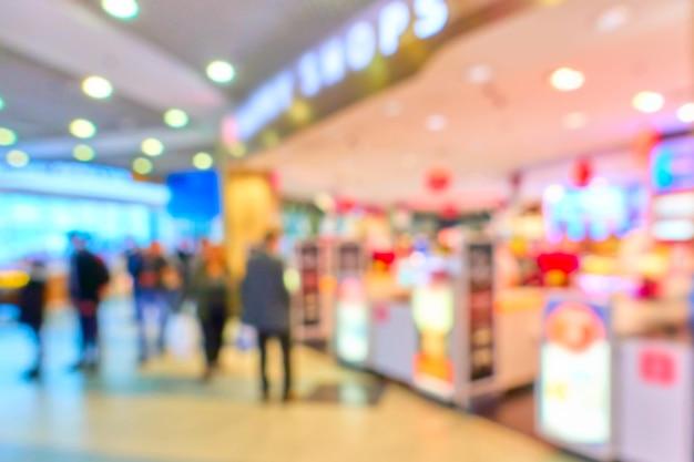 Tienda libre de impuestos en el aeropuerto fuera de foco - fondo desenfocado
