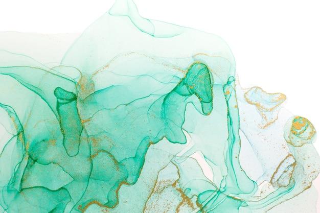 Tinta de alcohol oro y verde abstracto