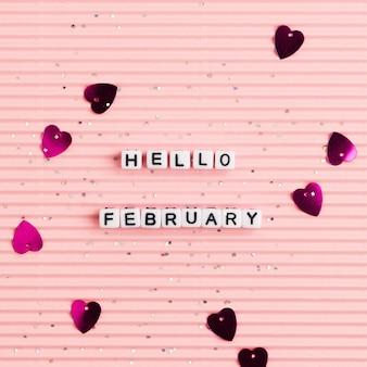 Tipografía de mensaje de perlas blancas hello february
