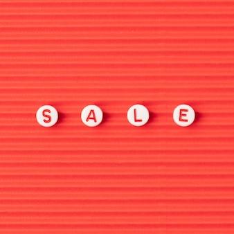 Tipografía de palabra de venta de abalorios de letras