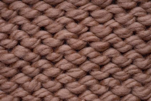 Tiro de macro de textura de tejido de punto de lana marrón.