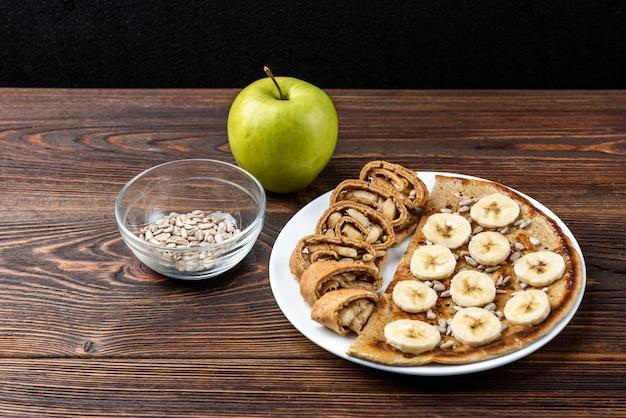 Tortita de avena con pipas de girasol y plátano