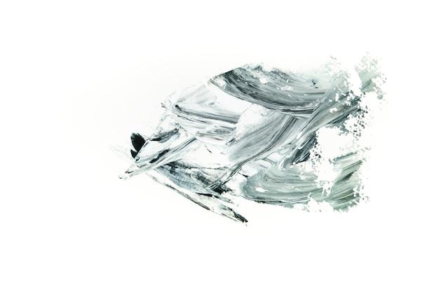 Trazo gris sobre lienzo blanco