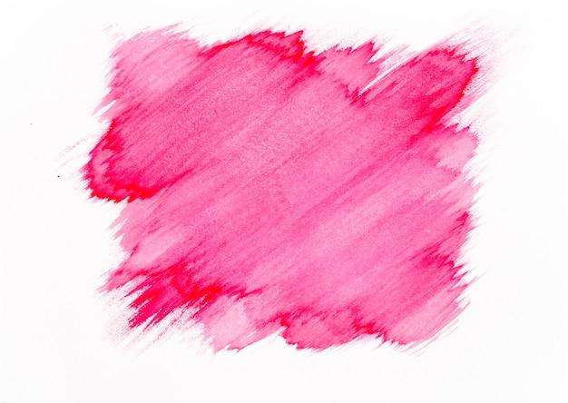 Trazo de pincel acuarela roja sobre fondo de papel blanco.