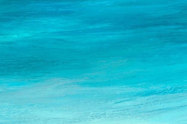 Trazo de pincel azul y verde azulado con textura de fondo