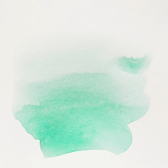 Trazo de pincel de color verde agua sobre fondo blanco