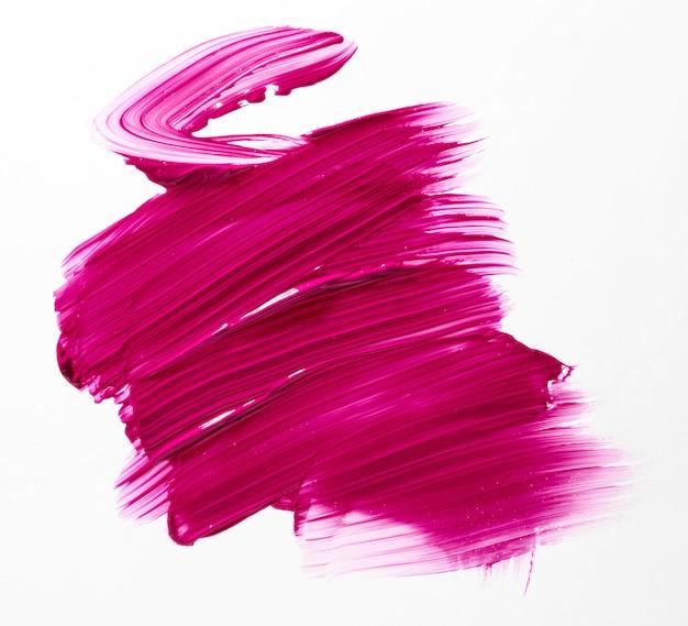 Trazo de pincel rosa con fondo blanco.