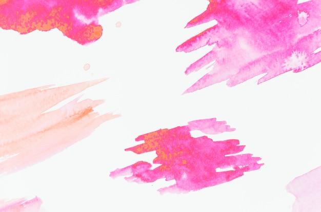 Trazo de pincel rosa sobre fondo blanco