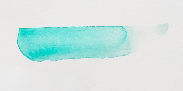 Trazo de pincel turquesa sobre fondo blanco