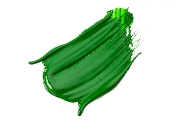 Trazo verde del pincel sobre papel blanco