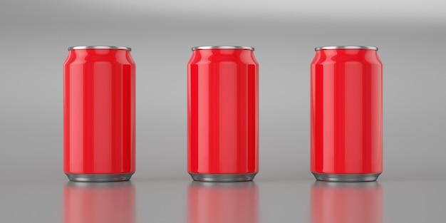 Tres latas de cola roja brillante sobre fondo de metal