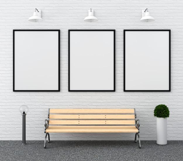 Tres marcos de fotos en blanco para maqueta en la pared