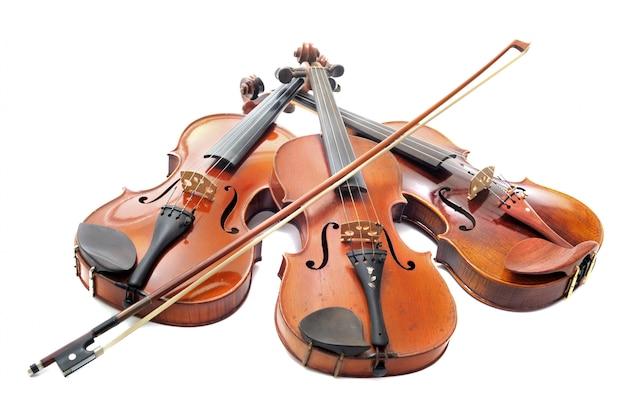 Tres violines
