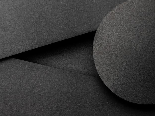 Triángulos negros y fondo de círculo