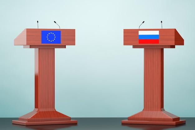 Tribuna del podio de madera se encuentra con banderas de la unión europea y rusia en el suelo