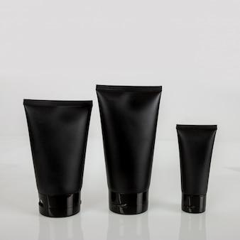 Tubo cosmético negro crema loción espuma facial protector solar maquillaje belleza cosmética base