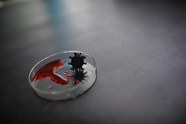 Tubo de ensayo con sangre del paciente para su análisis. análisis del virus. estudios de laboratorio sobre la pandemia de coronavirus. desarrollo de vacunas.