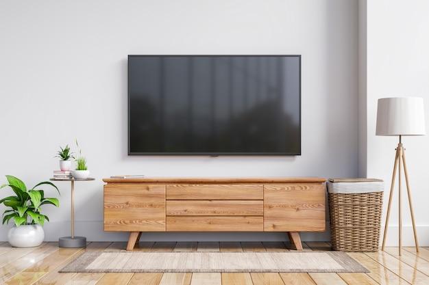 Tv en el gabinete en la moderna sala de estar en la pared blanca, representación 3d