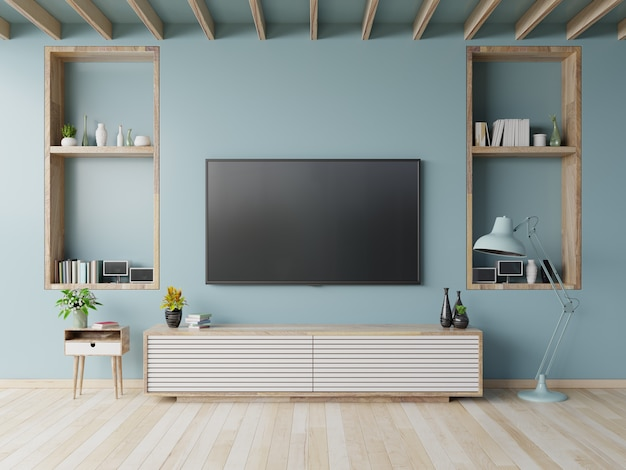 Tv en el gabinete en la sala de estar moderna en el fondo azul de la pared, representación 3d
