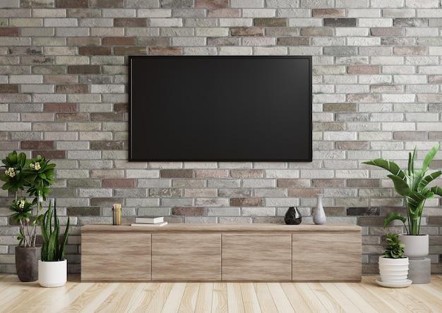 Tv en la sala de estar en una pared de ladrillos con gabinetes de madera y macetas en el piso. representación 3d.