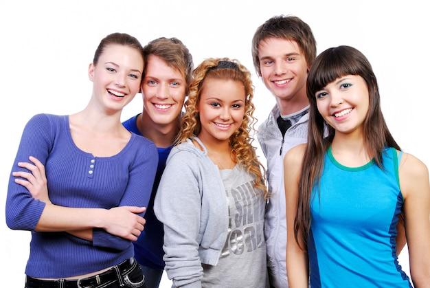Unidad de amigos felices compañeros de clase. foto de estudio sobre un fondo blanco.