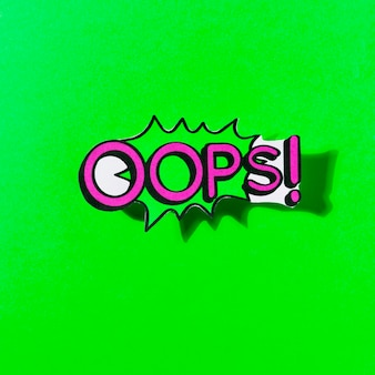 Ups! expresión de dibujos animados de discurso de burbuja cómico mensaje sobre fondo verde