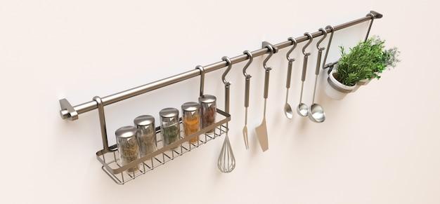 Utensilios de cocina, a granel seco y condimentos vivos en macetas cuelgan en la pared