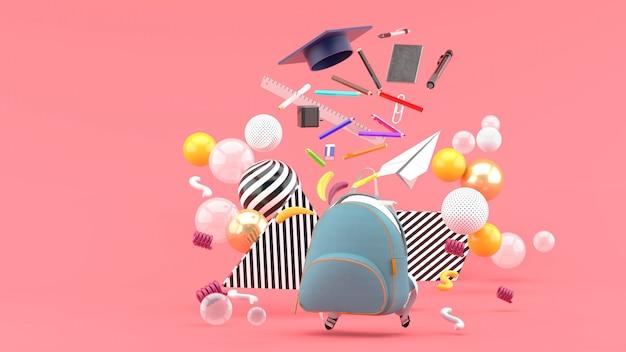 Útiles escolares flotando de una mochila escolar en medio de coloridas bolas de color rosa. render 3d