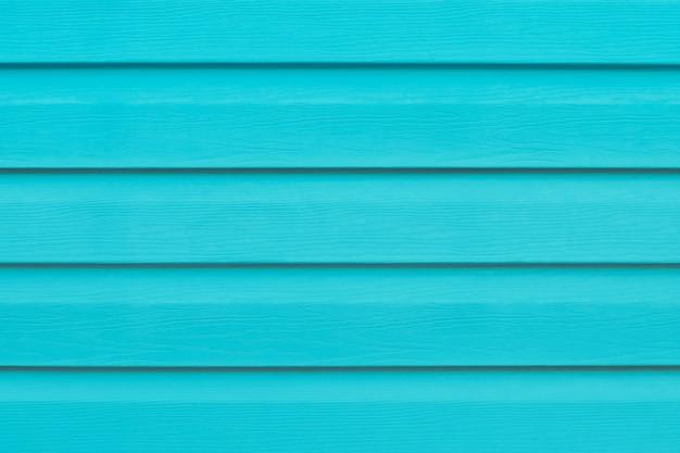 Valla turquesa. madera pintada con líneas.