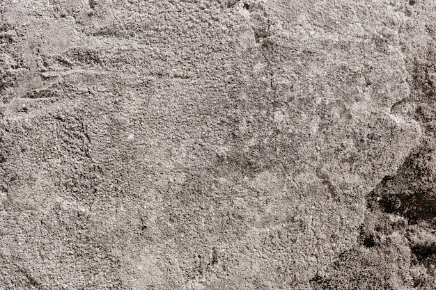 Vieja pared agrietada gris
