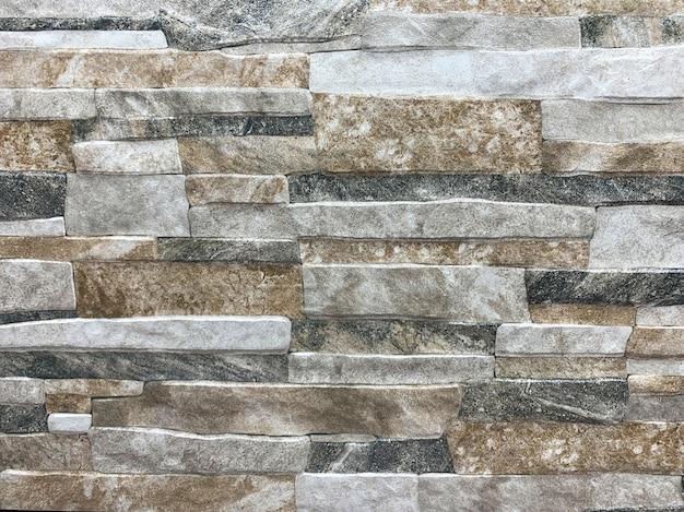 Vieja textura dinámica del patrón de la roca, fondo de la pared
