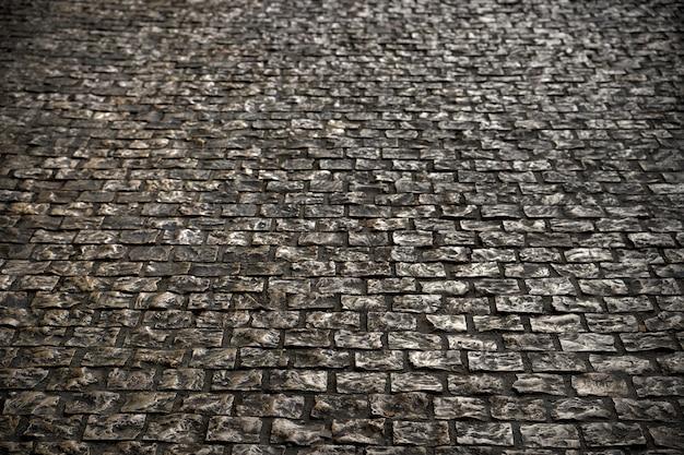 Vieja textura de la superficie de la carretera de adoquines vintage
