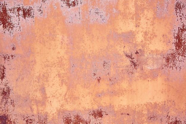 Viejo angustiado marrón terracota cobre oxidado espacio con textura rugosa inclusiones multicolores. gradiente manchado superficie gruesa granulada. fondo de pantalla