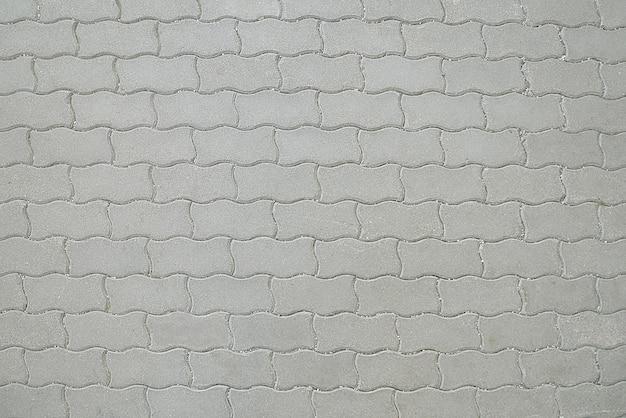Viejo camino textura de pavimento de mosaico gris