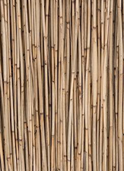 Viejo fondo de paja seca, textura de pared de bambú. concepto de fondo natural ecológico