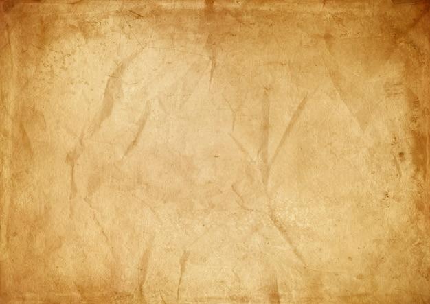 Viejo fondo de textura de papel arrugado marrón. papel pintado vintage