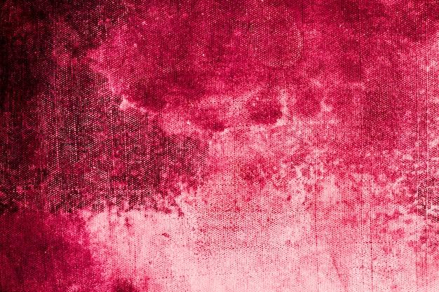 Viejo material de tela de rosa rubí con espacio de copia