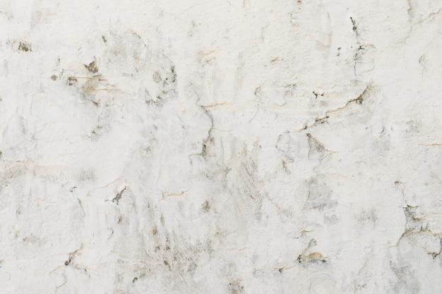 Viejo muro de hormigón está pintado con pintura blanca, fondo