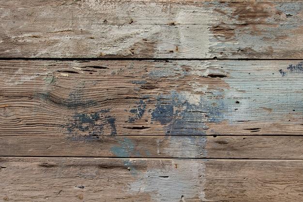Viejo patrón de madera horizontal en bruto con trazas de pintura, fondos de texturas de madera