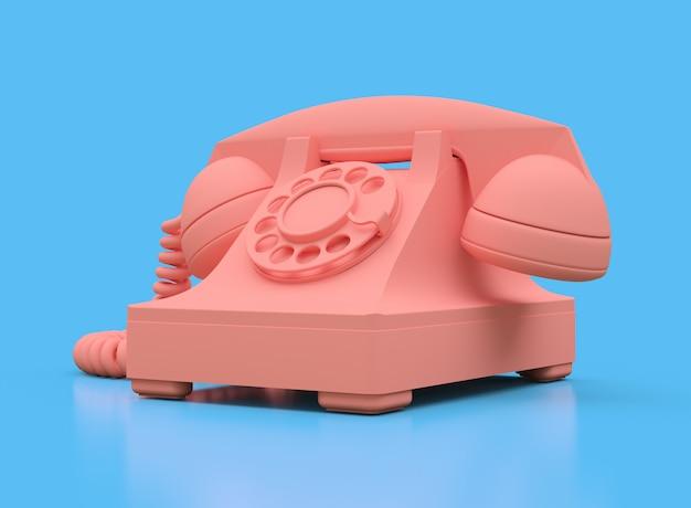 Viejo teléfono de marcación rosa sobre una superficie azul